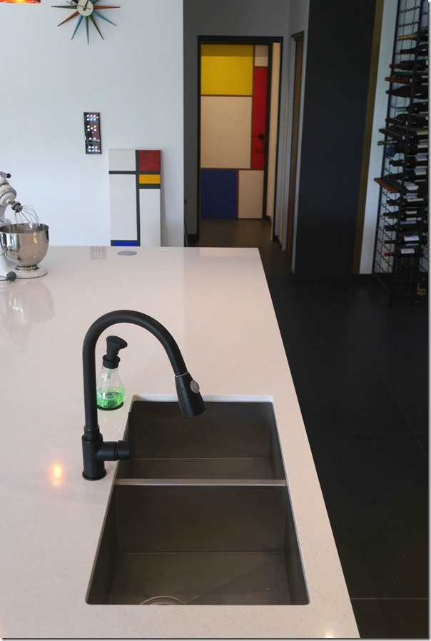Kitchen sink with matt black gooseneck mixer tap and foam soap dispenser