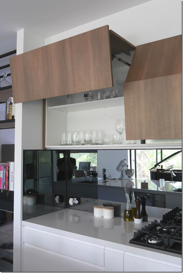Soft close overhead cabinets with adjustable height stops